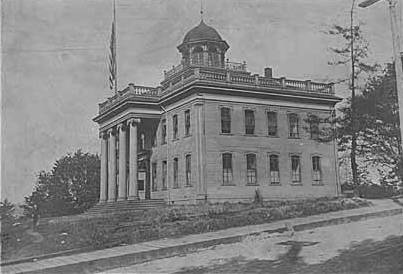 Territorial University on opening day, showing south and west sides of main building, November 4, 1861