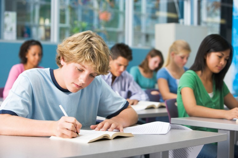 Students writing at desks