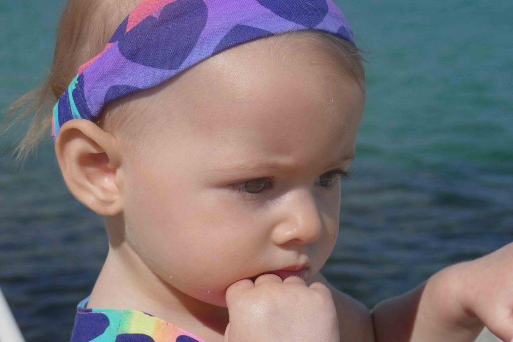 https://www.writteninwaikiki.com/10-tips-taking-better-photos-kids/ child looking thoughtful