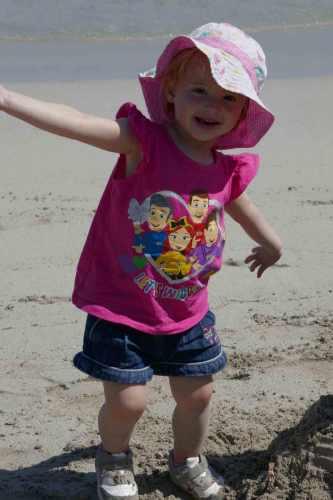 https://www.writteninwaikiki.com/things-i-want-my-daughter-to-know/ daughter girl child toddler smiling beach