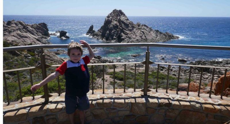 child standing at Sugarloaf Rock Yallingup Western Australia