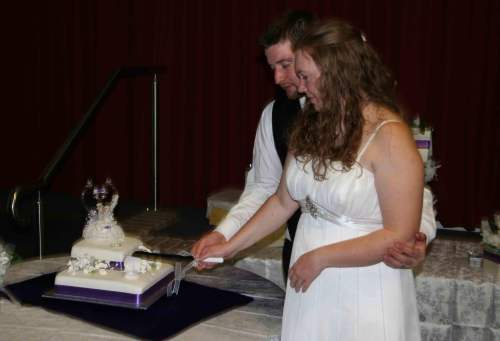 married couple cutting cake