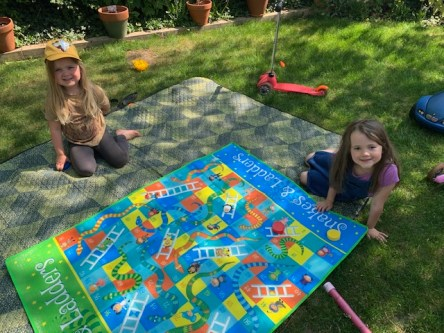 Ruby and Annabel play snakes and ladders