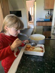 Lottie adding her crumble topping