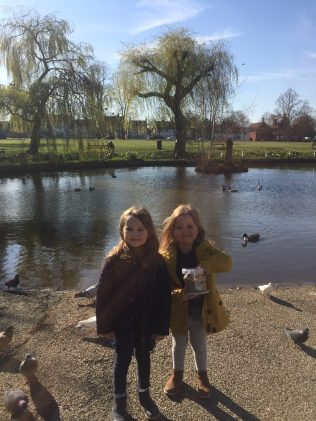 Ruby and Annabel feed the ducks