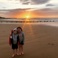 Freddie and Rosie watch the sunrise at Frinton