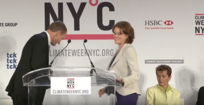 "September 20, 2010: Kelly Rigg (centre), director of GCCA/TckTckTck (Climate Week NYC partner) speaks during the Opening Ceremony for Climate Week NYC Monday in New York. Christiana Figueres is seated on the right. Rigg: ""And Christiana I just want to say, civil society has your back."""
