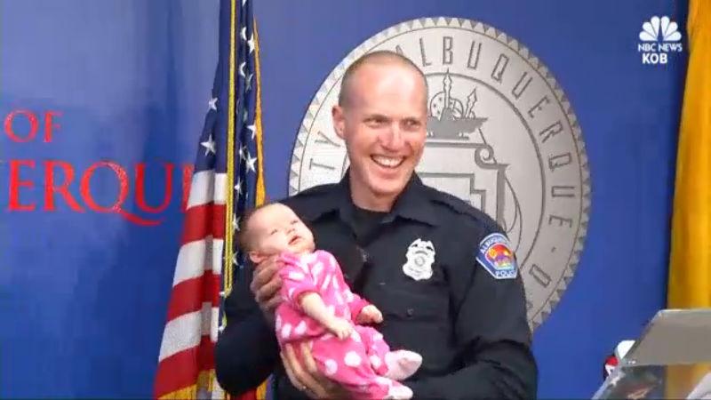 cop adopts baby_340915