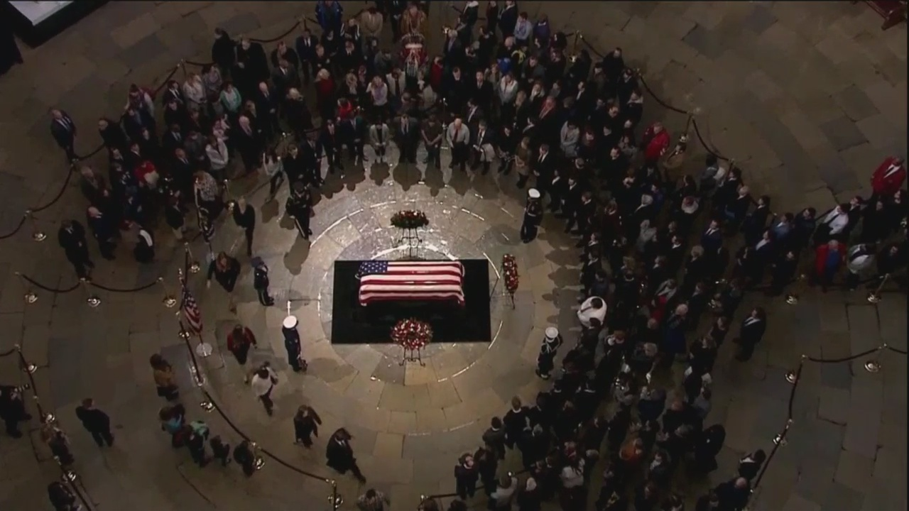 Thousands brave cold to honor President Bush