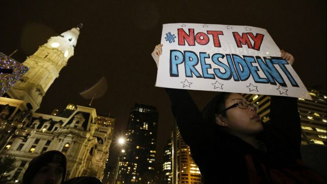 </p> <p>Maddy Ballard, of Philadelphia, participates in a protest in City Hall's Thomas Paine Plaza, Wednesday, Nov. 9, 2016, in opposition of Donald Trump's presidential election victory.</p> <p>