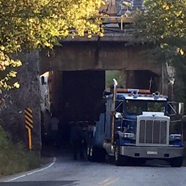 truck-stuck-under-trestle_259157