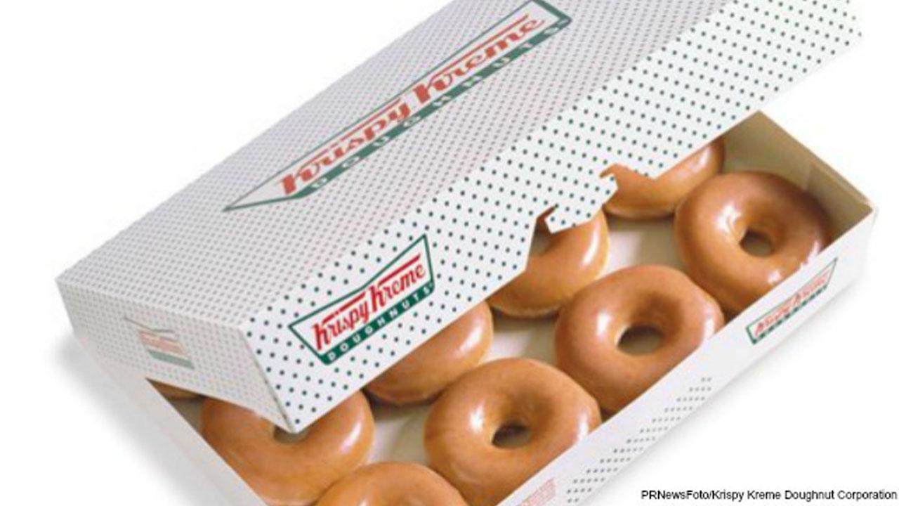 dozen Krispy Kreme donuts_416670