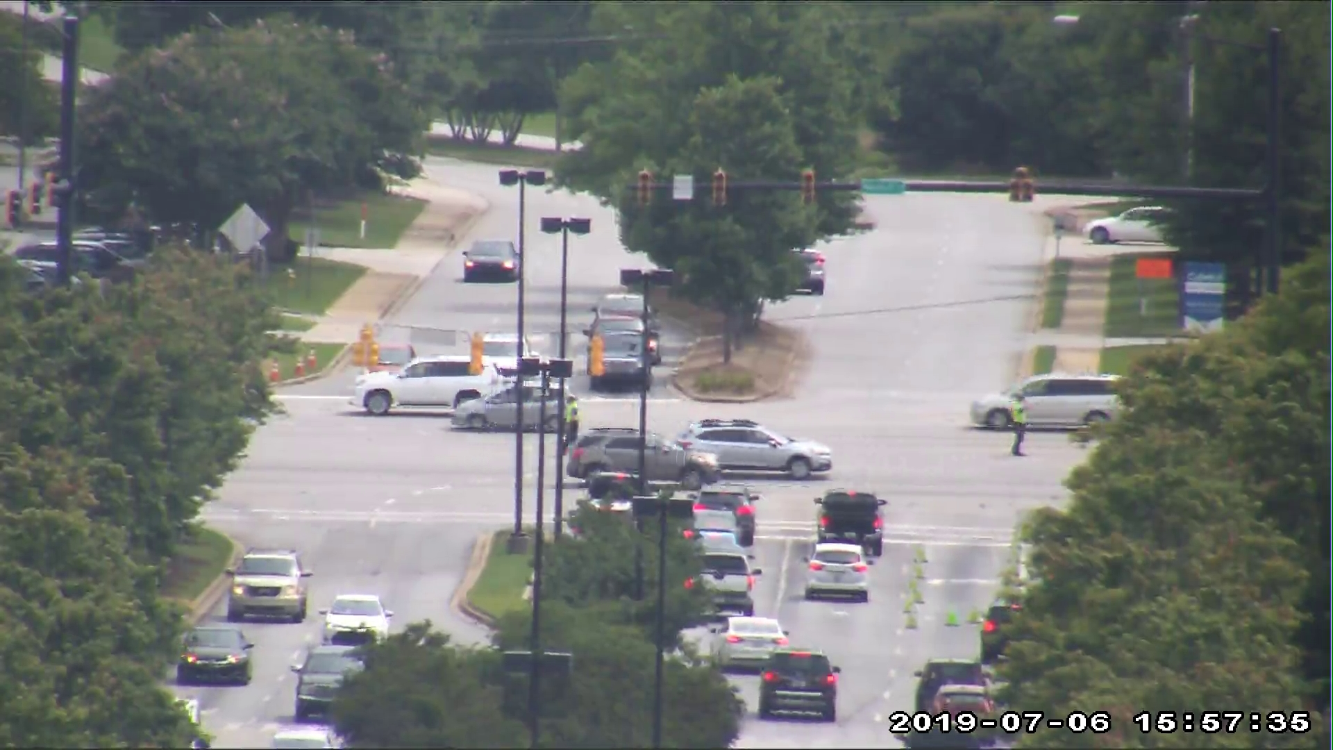 Greenville Police direct traffic at the intersection of Woodruff Road and Market Point Drive, Saturday, July 6, 2019.