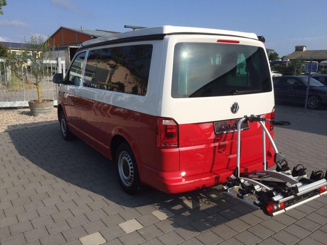 Ausgeliefertes Kundenfahrzeug (rot-weiß) - WSR Reisemobil / Camper / Caravan auf Basis des Volkswagen Transporter der 6. Generation