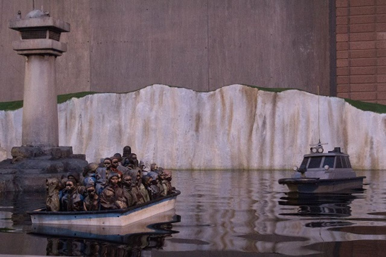 Migrants on a boat by Banksy