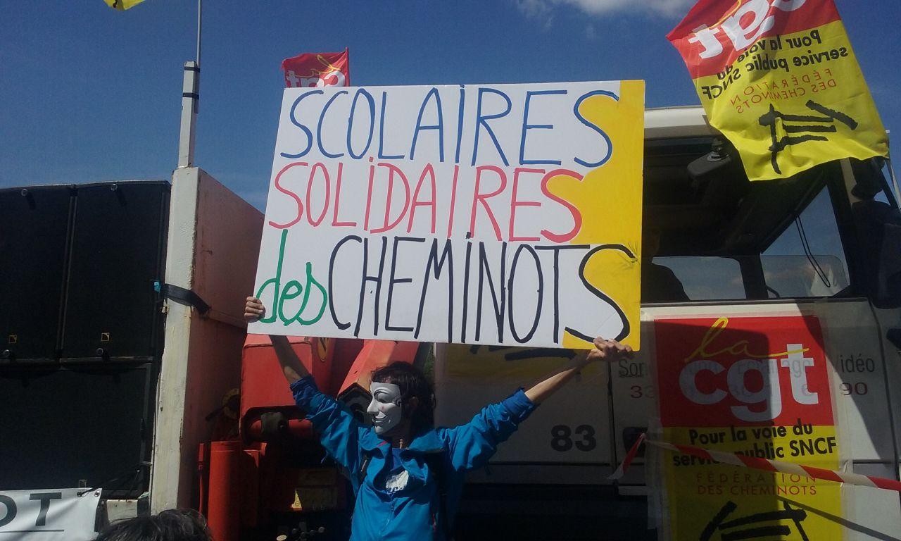 Paris demonstrator says Education workers in solidarity with the rail workers