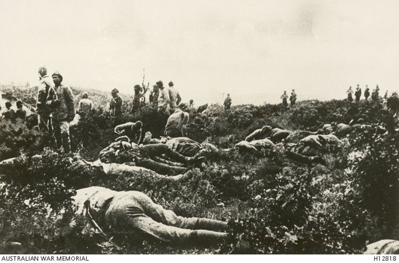 Turkish and Australian soldiers burying the dead at Gallipoli, May 1915. From Australian War Memorial