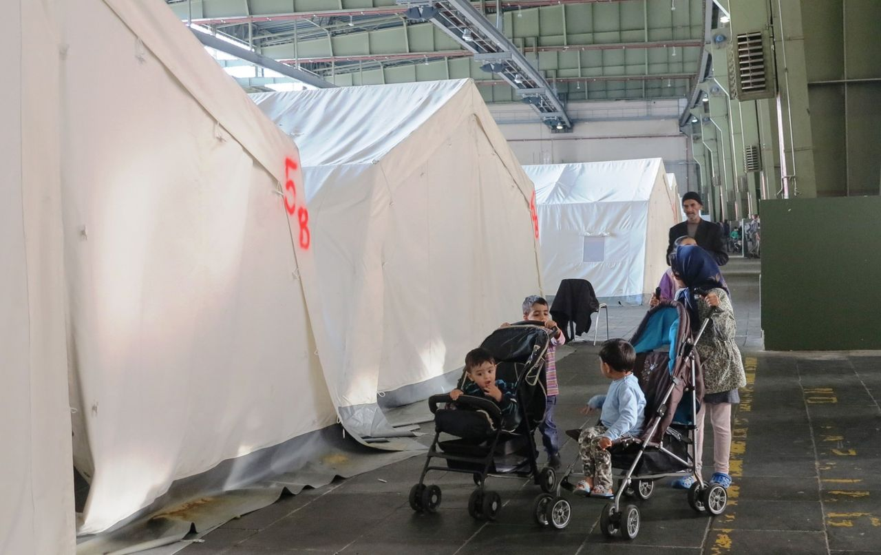 A refugee family in a hangar in Berlin