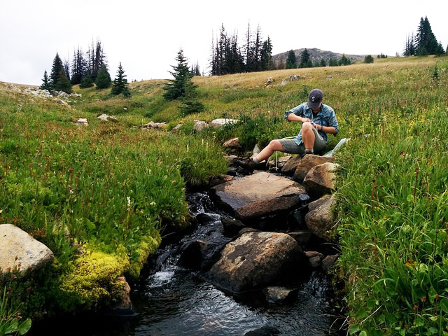 Filtering water from a creek in Horseshoe Basin. Photo by Loren Drummond