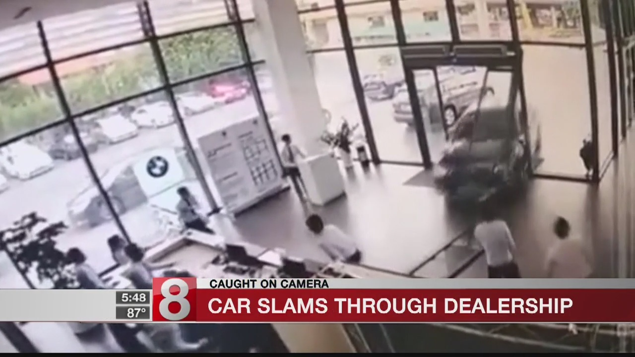 Woman plunges BMW into car dealership while taking test drive
