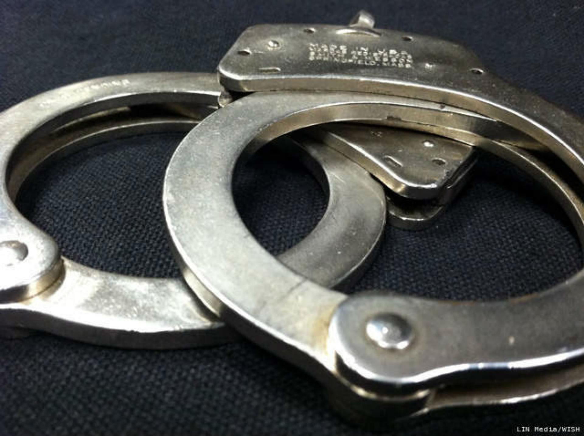handcuffs_1522336799023.jpg