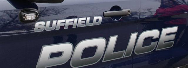 Suffield police investigate fatal car vs  dump truck crash