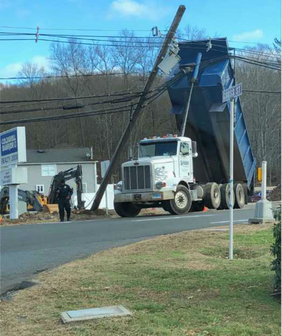 dump truck on power lines_1543516180417.jpg.jpg