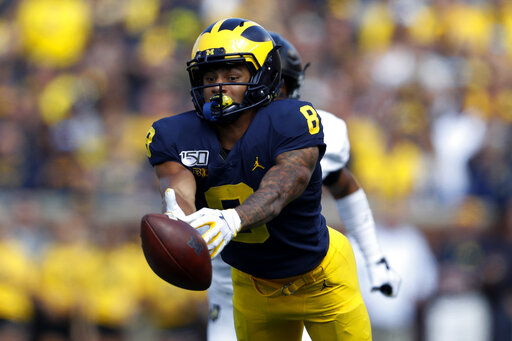No  7 Michigan holds on to beat Army 24-21 in 2 overtimes