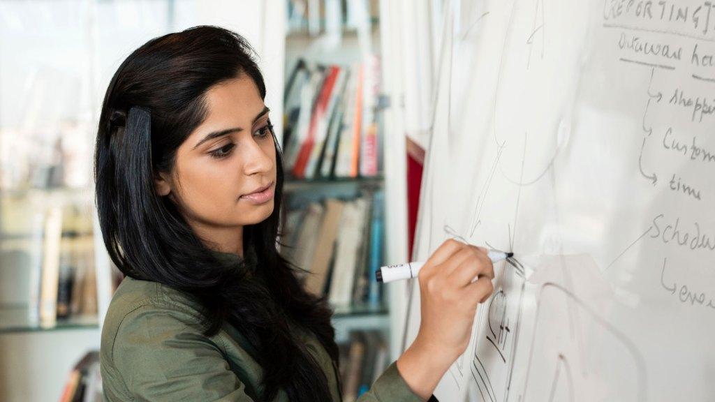 woman working on whiteboard