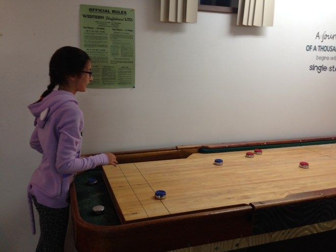 Cadence returns the shot! (no real shuffleboard rules were in effect)