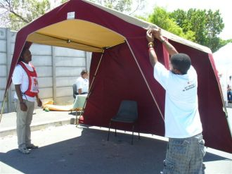 Putting up our new gazebo thanks to PEPFAR and the US Consulate
