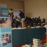 Reddam students fitting shoes