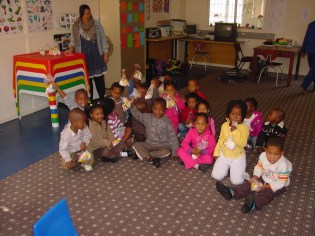Pre-Grade R learners with their party packs