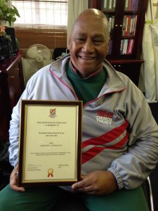Trevor Fortuin of the WUCT Advice Office displaying the Certificate of Compliance recently awarded by the Community Chest