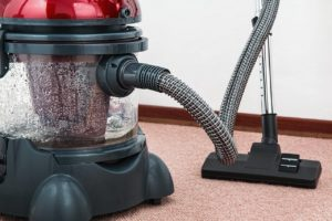 a canister cleaner on the carpet