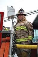 Ashley Jenkins dressed in firefighter gear