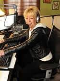 Dreama Denver sitting in her radio studio