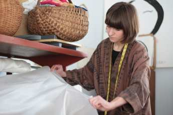 Nellie Rose Davis measuring out silk