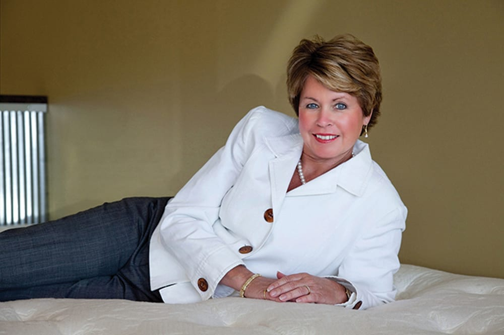Kim Brown Knopf lounging on a mattress