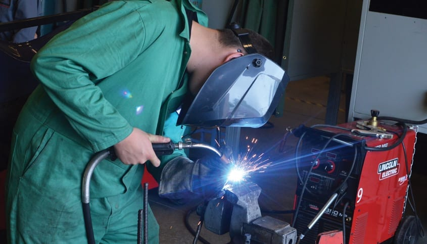 Man welding metal together
