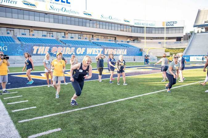 Ladies Huddle a hit with female Mountaineer fans