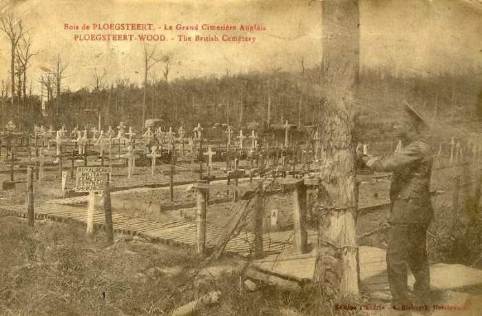 A soldier contemplates the graves at the Royal Berks Cemetery Extension