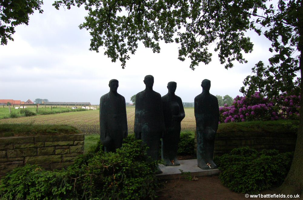 Sombre sculpture at Langemark German Cemetery