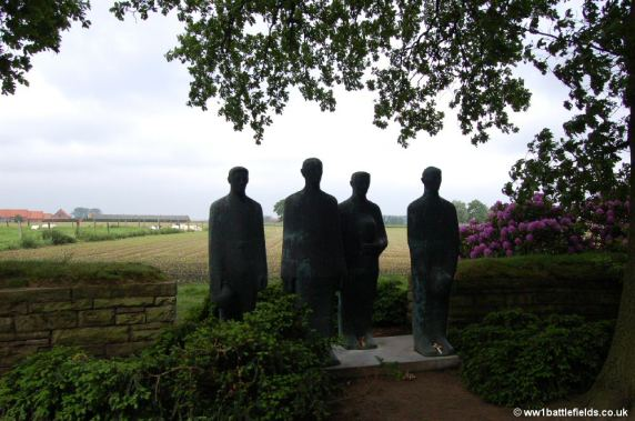 Sombre sculpture at Langemark German Cemetery