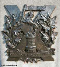 The brass insignia of the Tyneside Scottish