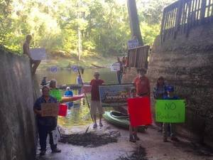 Protesters at Suwannee Campstes boat ramp.