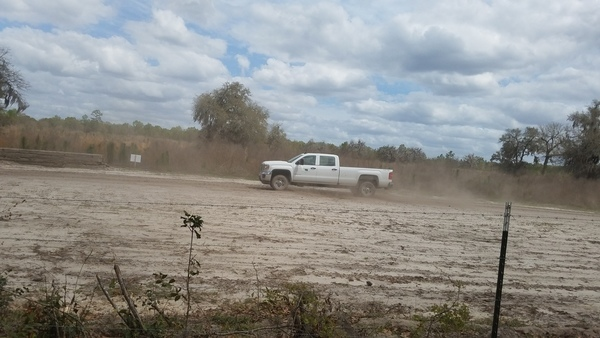 White truck (probably Price Gregory or Sabal Trail)