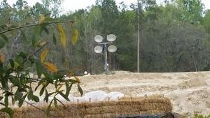 Hay, berm, lights, workers 30.4061111, -83.1527778