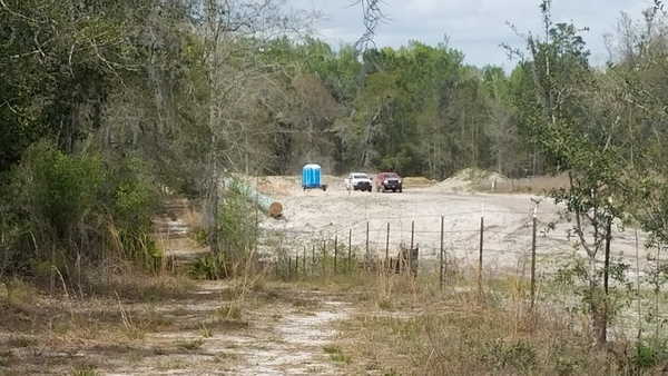 White and red trucks at HDD site