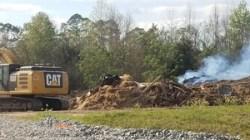Ties, lids, hay bales, black and white plastic on burn pile, 30.7658573, -83.5536063